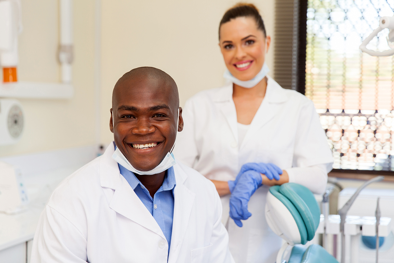 portrait of african dentist and assistant
